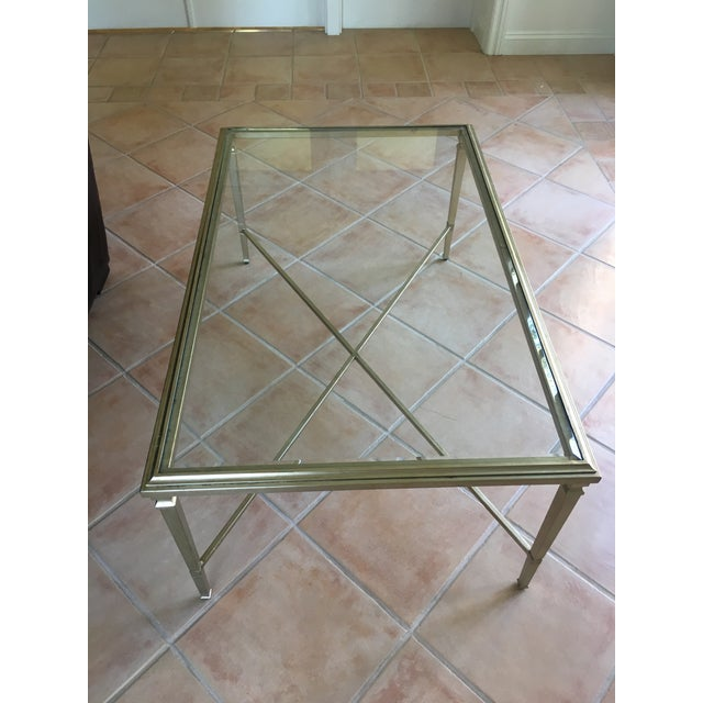 Opulence abounds with this coffee table in a classic rectangular shape, a jewel in any living space. It is sleekly styled...