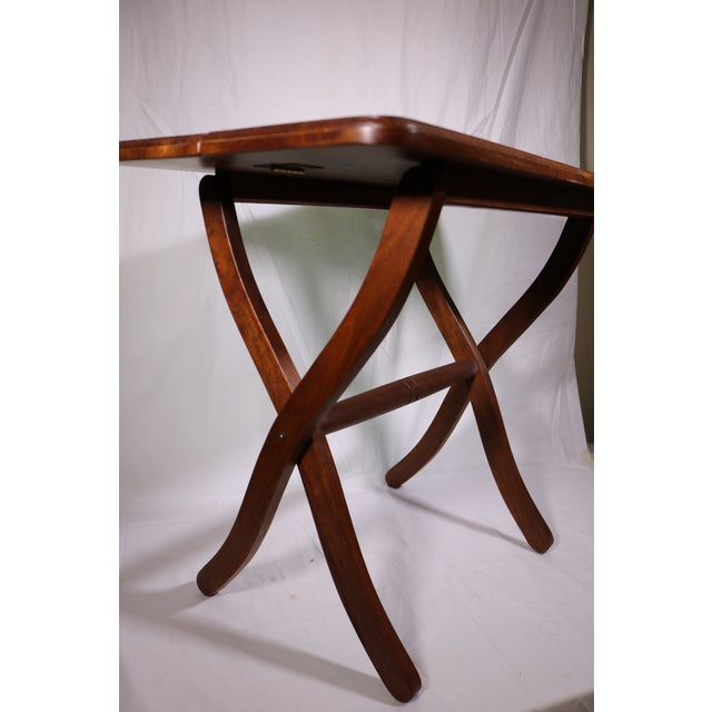 Southwestern style hardwood folding side table with a turquoise stone on the top. The piece is marked on the bottom with a...