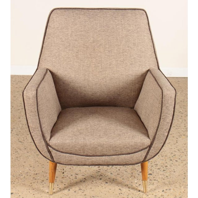 A pair of beautiful Italian mid-century modern upholstered chairs raised on brass-trimmed mahogany legs
