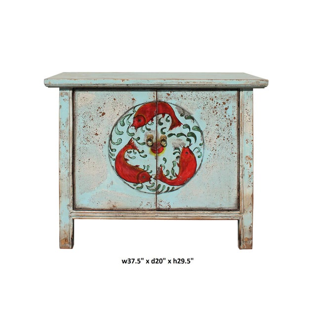 This is a side table cabinet with two doors. The surface is finished with rustic distressed light pale blue lacquer color....
