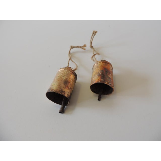 """Pair of Gold Leaf Iron Indian Holiday Christmas Tree Ornaments With iron bells. Size: 1.25""""D x 6""""H"""
