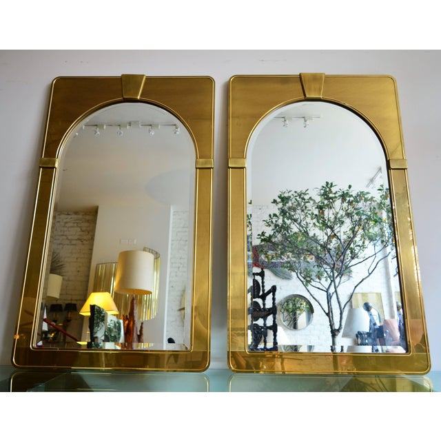 Mastercraft pair of brush brass arched Palladian beveled wall mirrors. Uber sophisticated stylized architectural...