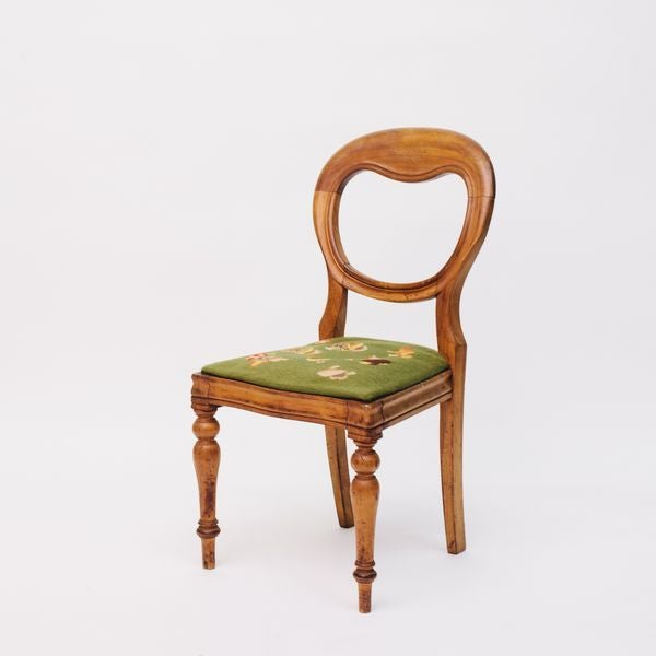 Sometimes, a standout piece could be as simple as a pretty little side chair. This shield back, petit point seated chair...
