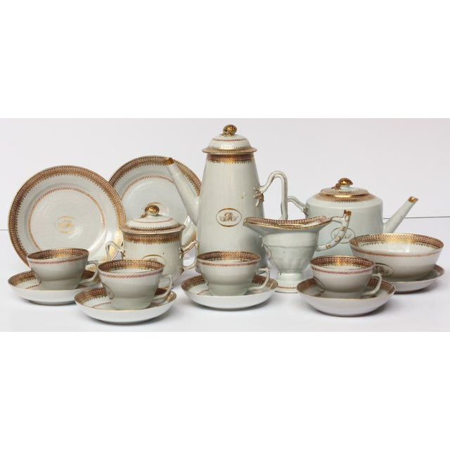 A set of monogrammed, GM, Chinese export porcelain with beautiful gilt border: Includes both coffee and tea pots with...