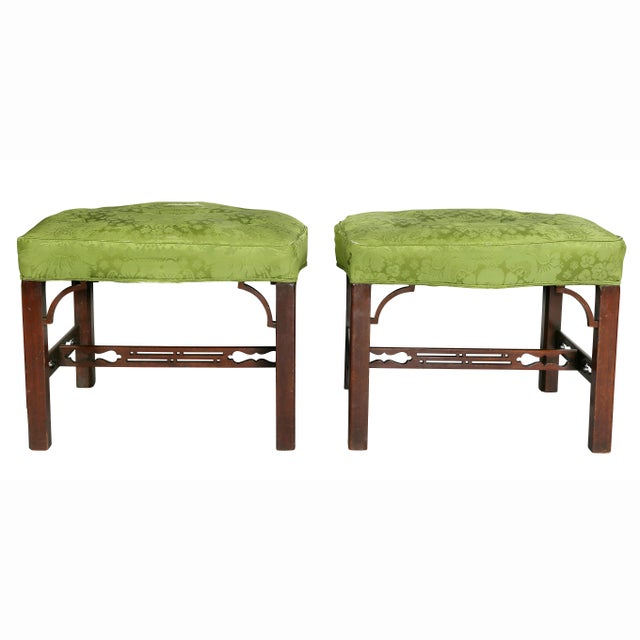 Each with upholstered seats and square legs with bracket corners and joined by pierced stretchers.