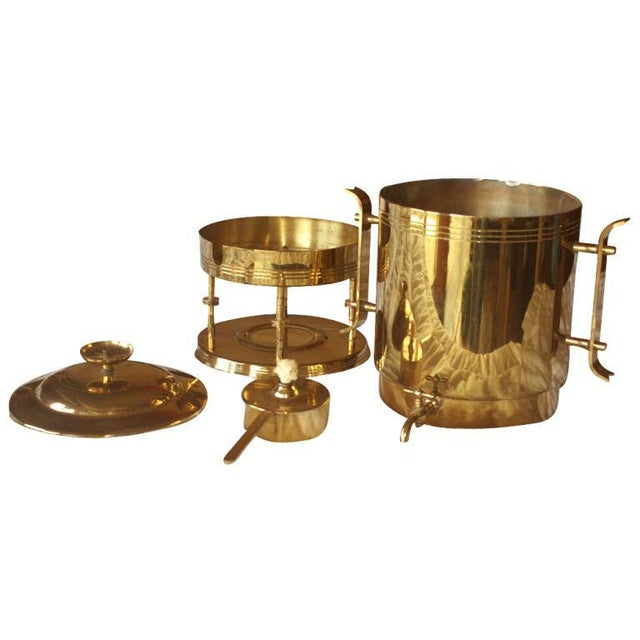 A Mid-Century Modern urn for coffee or hot water designed by Tommi Parzinger and made by Dorlyn Silversmiths. Brass with...
