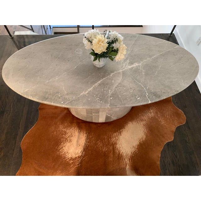 A sleek, ovoid shaped vintage Italian marble table from the 1970s with faceted base. This wonderfully versatile table can...