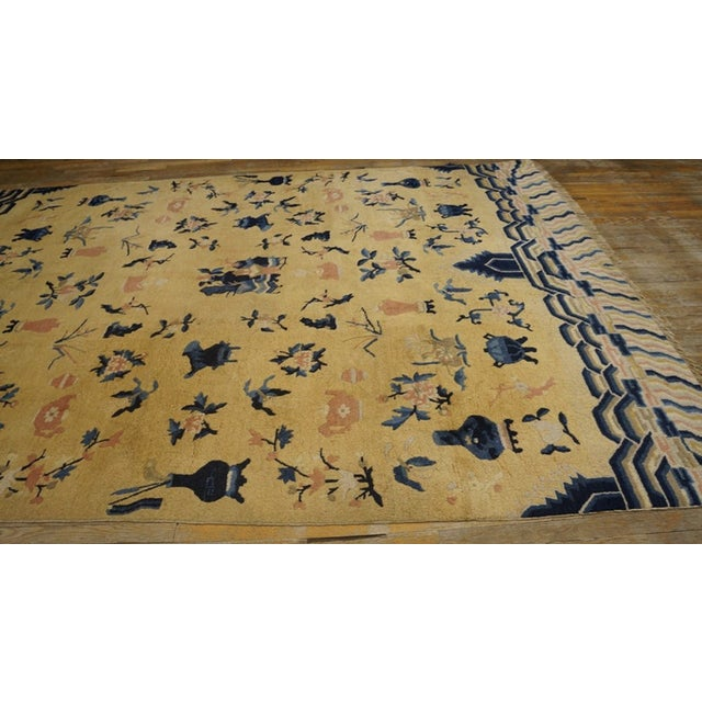 Antique Chinese - Ningxia Rug with a yellow background.