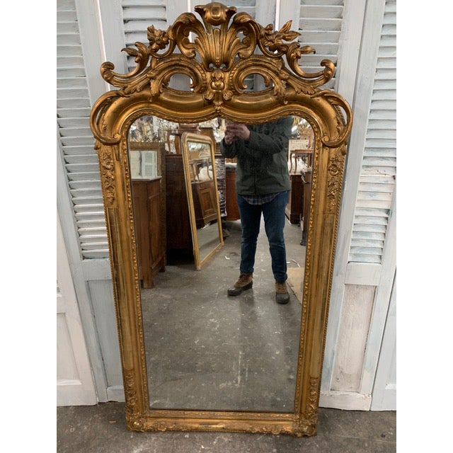 Original 18th Century Grand French Louis Philippe mirror beautifully showcases the classic details of any Louis Philippe...