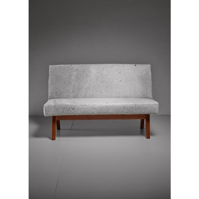 A bench from the Chandigarh High Court, by Pierre Jeanneret. The bench stands on four teak legs and has a white cowskin...