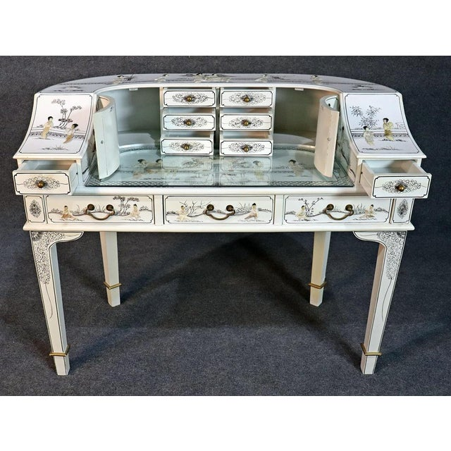 This is a fantastic white lacquer carved figure Chinoiserie Carlton House desk. The desk is in very good condition with no...