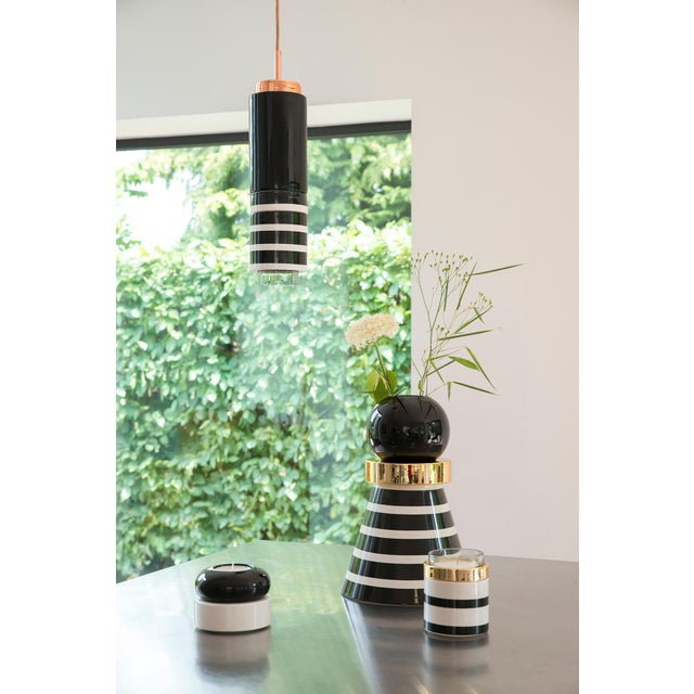 Spheric vase by Eric Willemart Dimensions: H 35.5 cm Ø 24 cm Eric Willemart overthrows design codes with its evolutive...