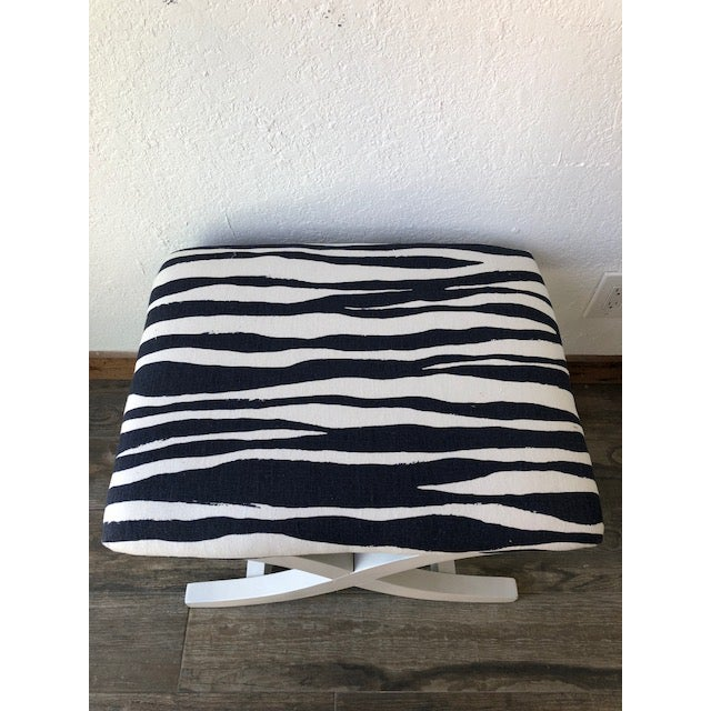 """Classic style x-bench in a bold contemporary print. Newly upholstered in large scale navy blue/white zebra print """"Mona..."""
