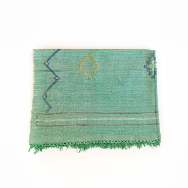 Cactus silk rug in soft green, embroidered with Berber symbols adds a pop of color and chic bohemian vibe. Can be used as...