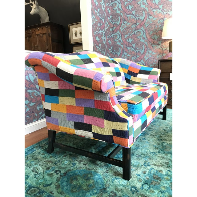 A traditional style with an unexpected twist to a camel back loveseat. The fabric is a cotton poly blend. Hand assembled...