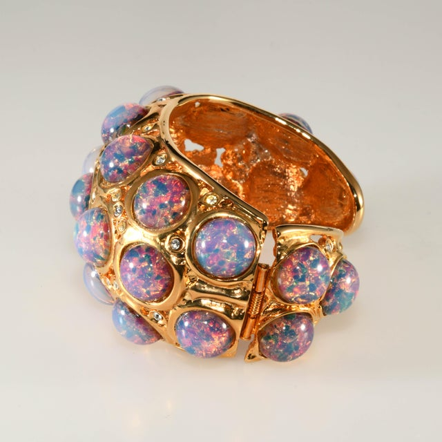 Kenneth Jay Lane hinged cuff bracelet with faux opal foiled glass cabochons set in gold plated metal with clear rhinestone...