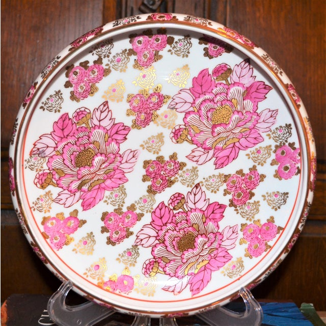 This is a beautiful Pink and Gold, Gold Imari porcelain platter. This platter is round and is sort of a cross between a...