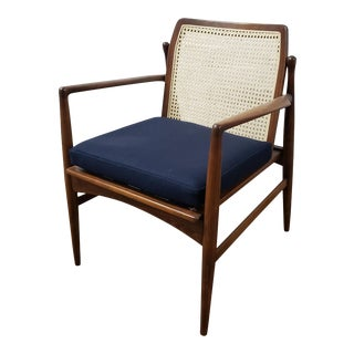 Ib Kofod-Larsen for Selig Cane Back Walnut Armchair For Sale
