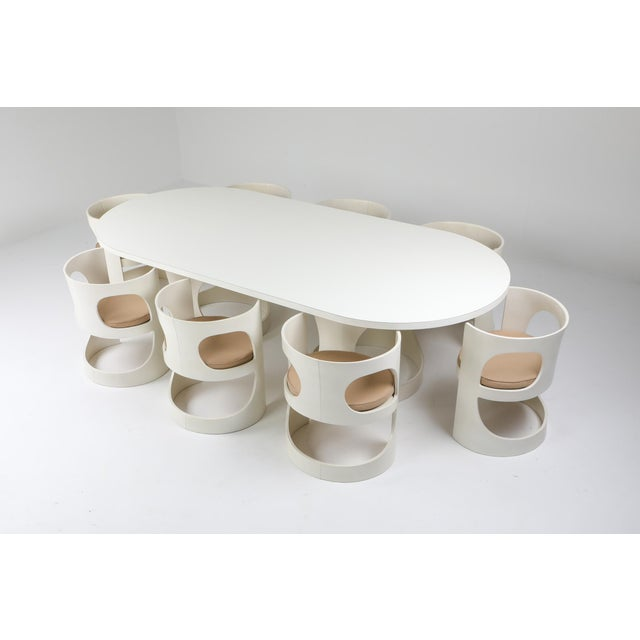 Space Age pre pop dining table and 9 chairs designed by Arne Jacobsen and manufactured by Asko, Finland 1969. This...
