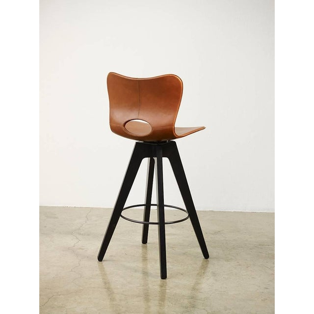 The AKMD collection Lariat barstool is hand-stitched by traditional saddle makers in North India. The seat is top-grain...