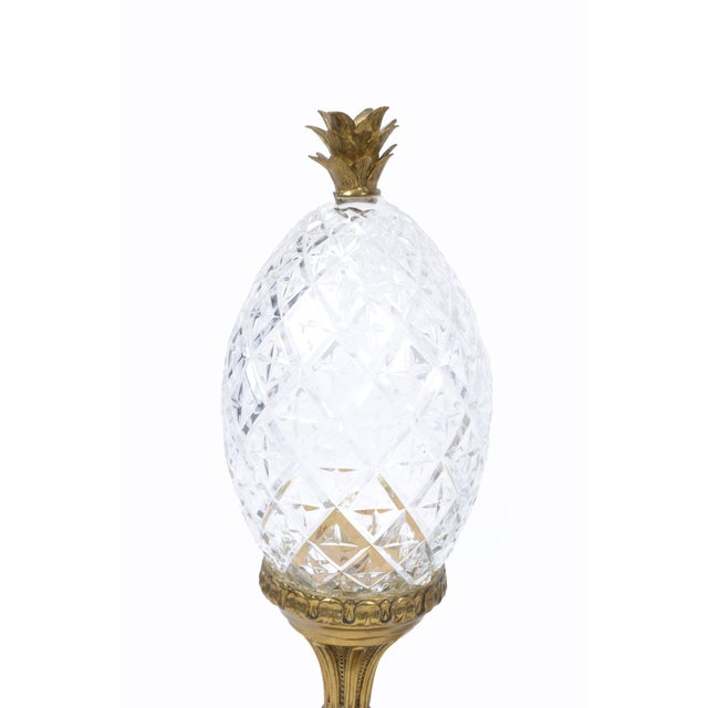 A pair of Maitland-Smith bronze and crystal pineapple ornaments, Germany.