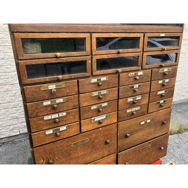 VINTAGE INDUSTRIAL WOOD CABINET. Beautiful salvaged cabinet; probably from a trade store (hardware, jeweler, apothecary,...