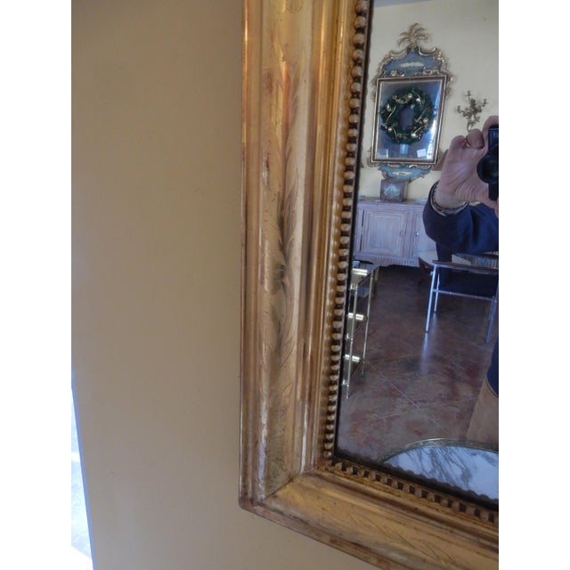 Very nice size 19th century Louis Philippe mirror with quality gold gilding and etching. The mirror has its original...