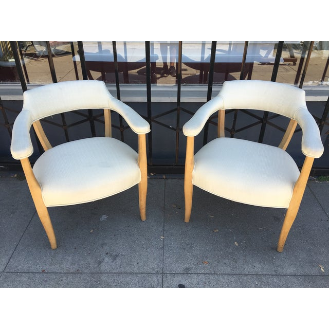 Gorgeous pair of sculptural mid-century armchairs (look at the sexy curves on those frames!). The frames on these chairs...