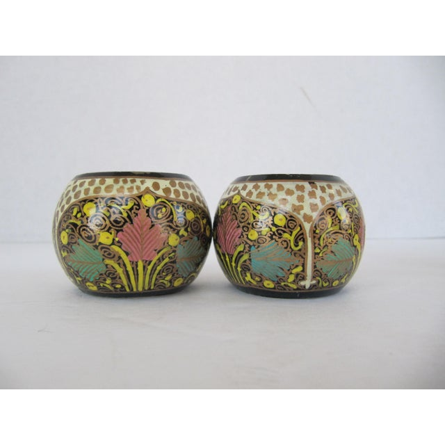 6 vintage hand painted Indian napkin rings. 4 of the same design and 2 of the other. Coordinate well together.