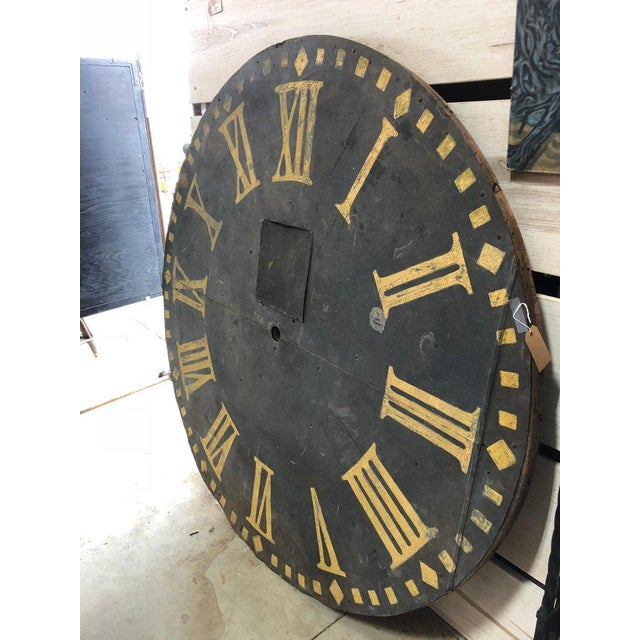Over 5ft diameter antique metal Clock face with wooden back.