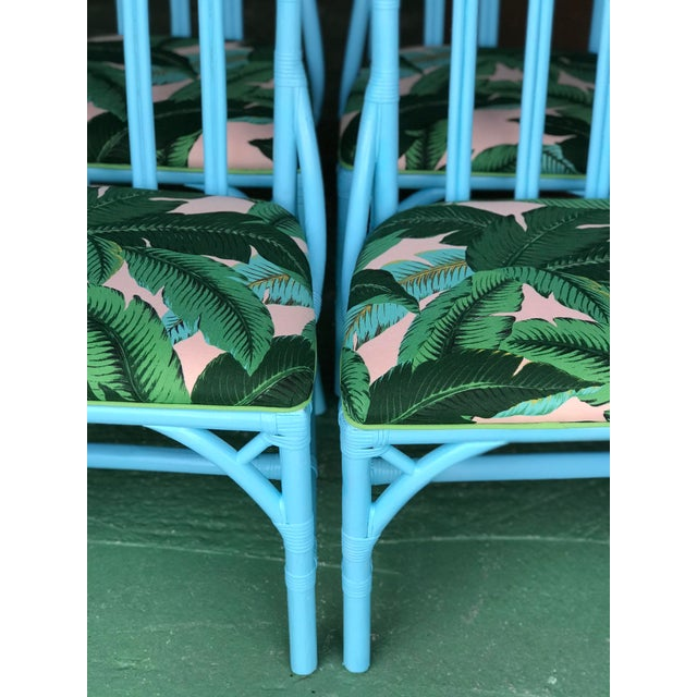 Freshly painted turquoise Lexington Rattan Cathedral chairs upholstered in an outdoor palm leaf fabric. Please zoom in on...