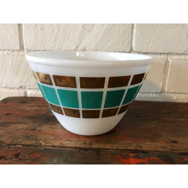 Mid century milk glass bowl with a turquoise and metallic gold pattern designed by Fred Press. In great condition with a...