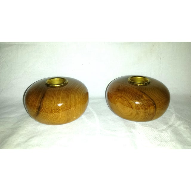This is a pair of Mid-Century wooden ball candle holders with beautiful grain in their myrtle wood from Oregon and brass...