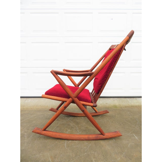 Excellent solid teak, Danish modern, rocking lounge chair in outstanding original vintage condition. Vibrant cherry red...
