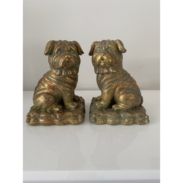 Pair of gilt Pug dog bookends. Excellent condition. Cast ceramic with cool patina. No marking on bottom but pretty sure...