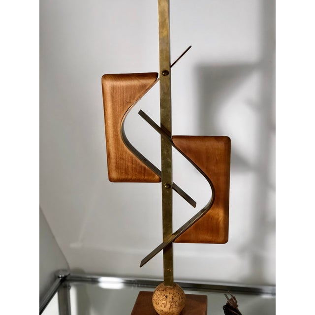 Circa 1960s tall mid mod lamp with sculptural pieces of walnut and cork assembled with brass.