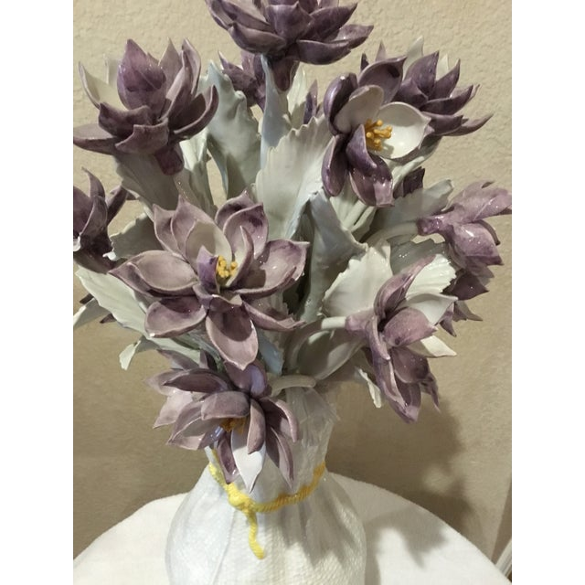Dramatic ceramic floral arrangement from Italy. It is done in tones of purple and is unusual to say the least. It is heavy...