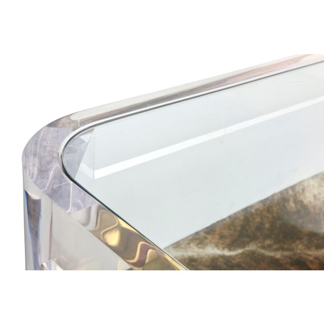 This great signed Les Primatiques rectangular lucite and glass cocktail table is called the Luna table and is from the...