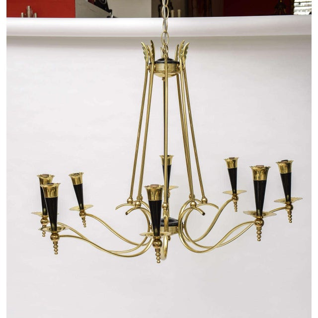 Offered is an Italian chandelier in a gorgeous metallic brass finish with black accents. This beauty features eight socket...