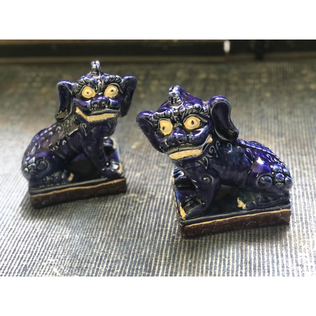 A perfect condition pair of porcelain Fu/Foo dogs, very collectible from mid 20th Century. Foo dogs are actually Chinese...
