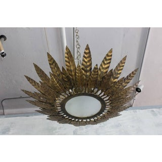 Flush Mounted Sunburst Ceiling Fixture With Leaves Preview