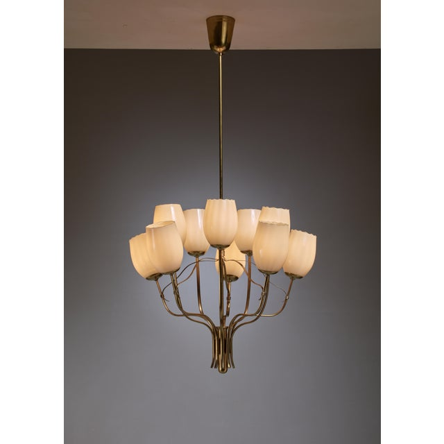 This wonderful Paavo Tynell chandelier was designed for the Sokos Helsinki-house. It has ten arms, each with a beautiful...