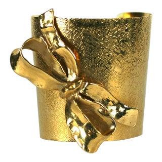 Yves Saint Laurent Gilt Bow Cuff For Sale