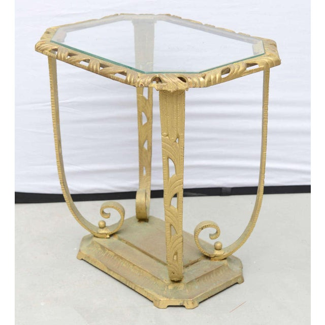 Beautiful heavy glass and metal Hollywood Regency side table from the USA 1930s.