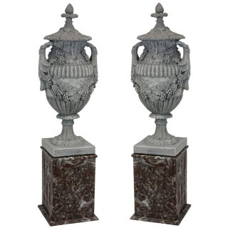 Pair of Large Plaster Urns on Marble Plinths