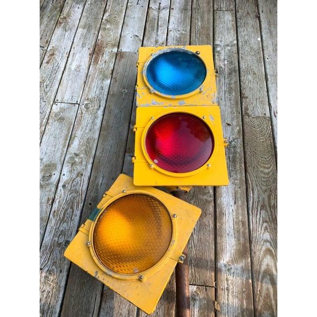 Econolite traffic signal. This is an original, heavy, traffic signal with the original colored lenses intact. Each light...