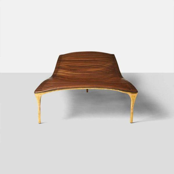 A large scaled daybed in hand worked brass with walnut cross beam support. Shaped to support a reclining body, the daybed...