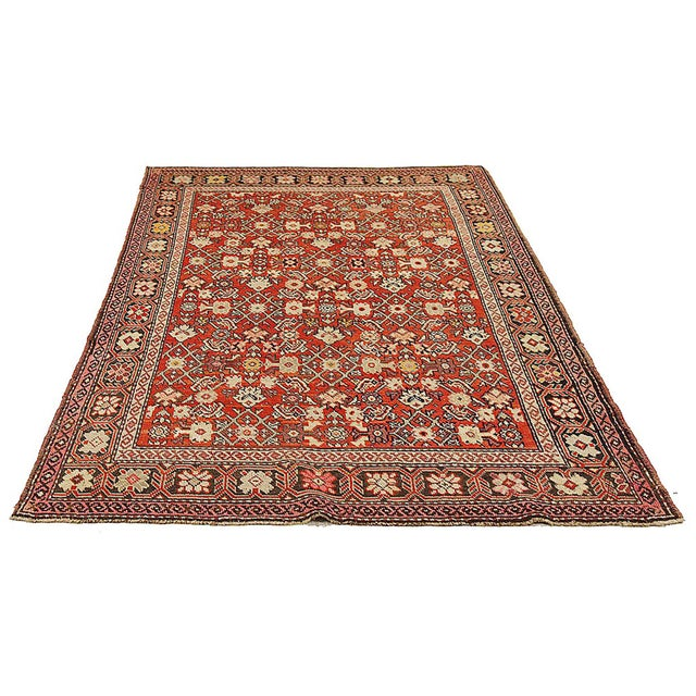 Antique Persian rug handwoven from the finest sheep's wool and colored with all-natural vegetable dyes that are safe for...