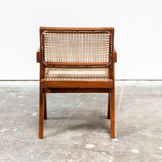 An iconic office armchair by Pierre Jeanneret for the administration buildings in Chandigarh, India, 1950s. In teak and cane.
