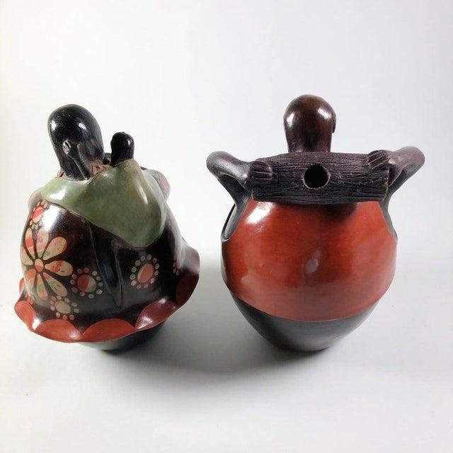 "Peruvian Folk Art Pottery Figures - Man and Woman by Juan Sandoval | 9"" x 6"" each Minor wear as seen in photos. Beautiful..."